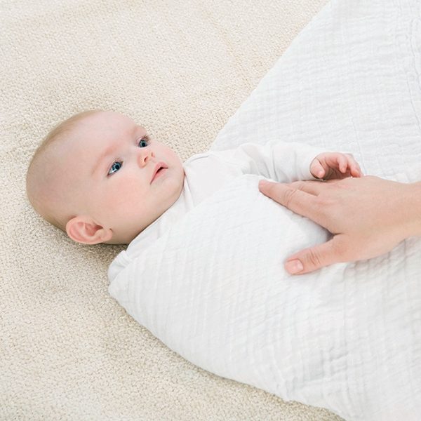 Swaddled baby with one arm out