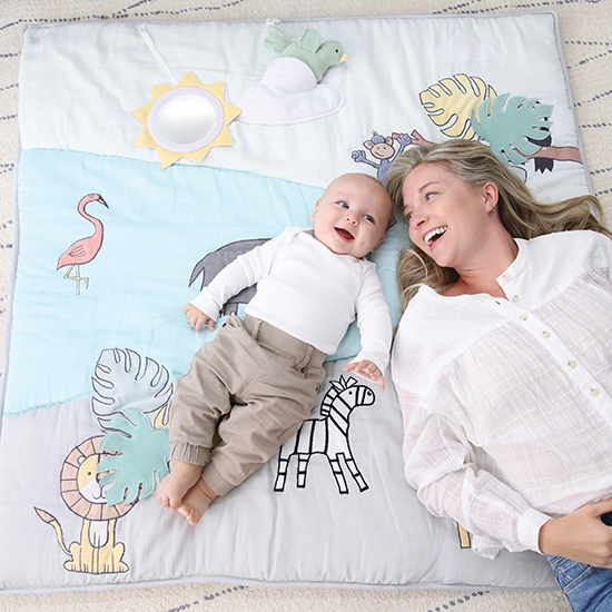 Baby and Mom lies on Aden and Anais Blanket - Aden and Anais