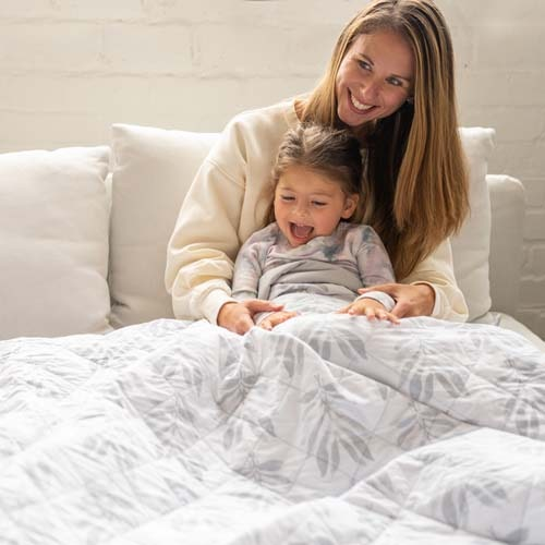 mom and daughter using lounge weighted blanket