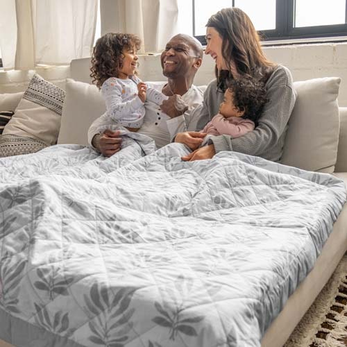 family sitting on couch with lounge weighted blanket