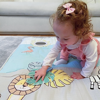 baby playing on mat