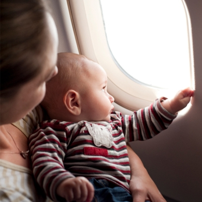 Baby looking out an airplan window