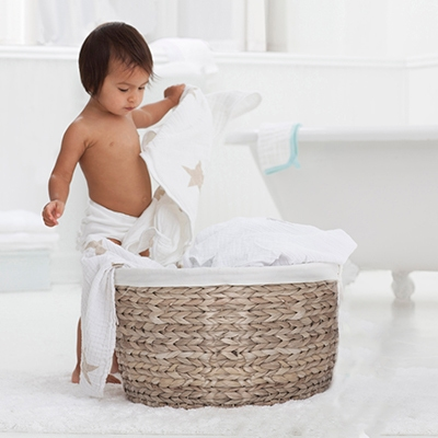 Baby going through laundry basket
