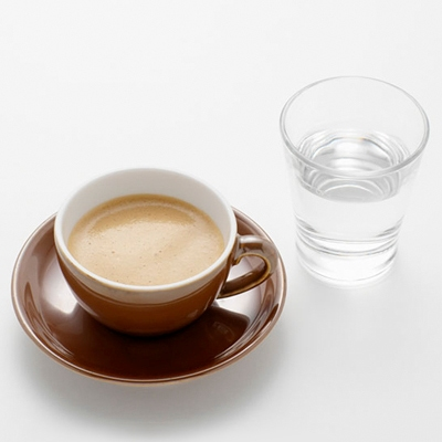 Cup with coffee and glass with water - Aden and Anais