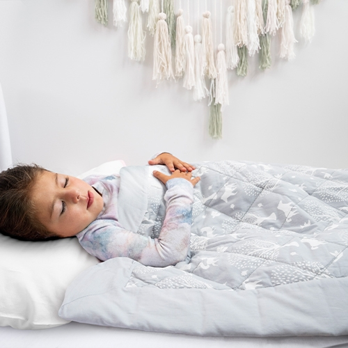 little girl sleeping with toddler-bed weighted blanket