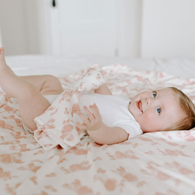 Baby lying on a blanket - Aden and Anais