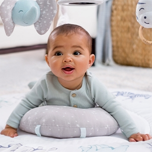 baby doing tummy time on the aden + anais play + discover activity gym
