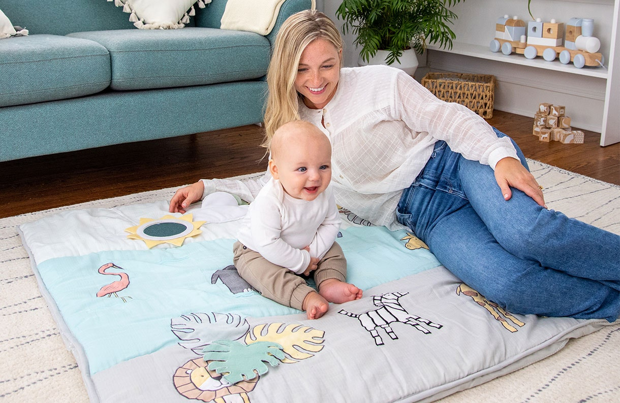 Mum and baby playing on the baby bonding playmat