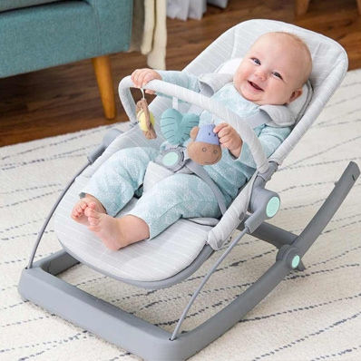 baby smiling on aden + anais baby bouncer + rocker + seat