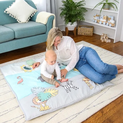 mum and baby playing on the baby playmat