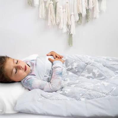 aden + anais baby sleeping on embrace toddler blanket