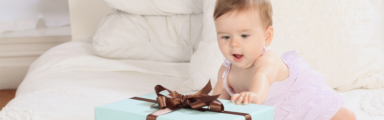 Suprised baby with a gift