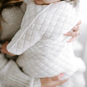 Mom hugs the baby - Aden and Anais